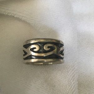 Silver tribal band ring.